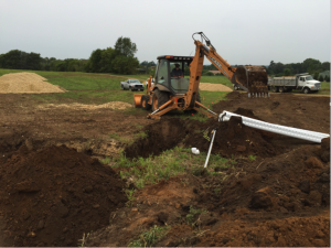 Excavating for new septic field